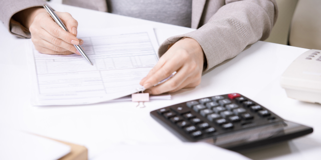 Book Debt - Woman with Finance Documents - Nash & Co Solicitors