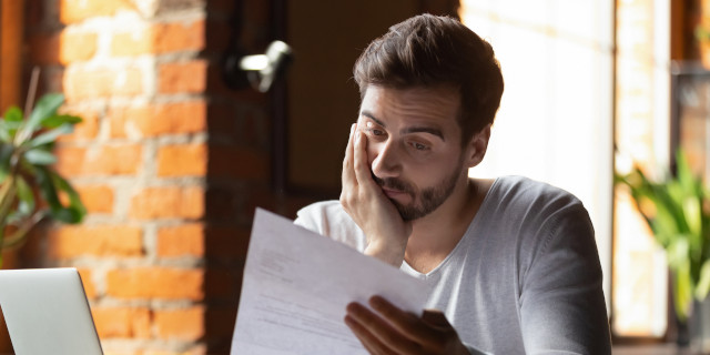 Commercial Disputes - Man with Paperwork - Nash & Co Solicitors