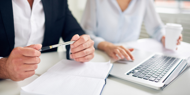 Debt Recovery - Discussing Work on Laptop - Nash & Co Solicitors