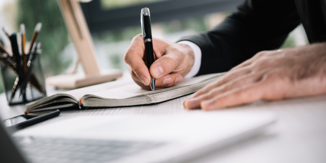 Ground Rent - Businessman Writing - Nash & Co Solicitors