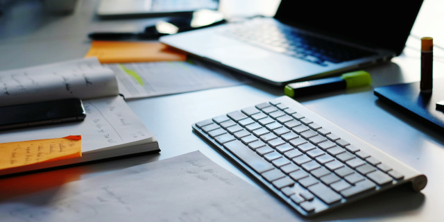 Intellectual Property - Technology Filled Desk - Nash & Co Solicitors
