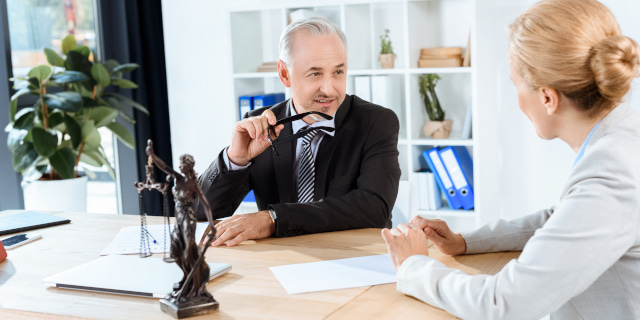 Lasting Powers of Attorney - Lawyers Talking Over Documents Child - Nash & Co Solicitors