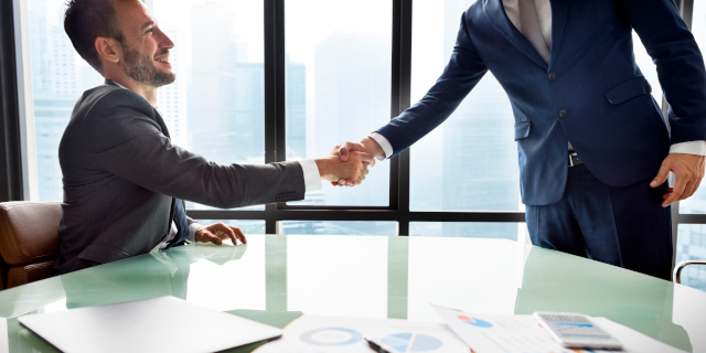 Mergers and Acquisitions - Business Handshake - Nash & Co Solicitors